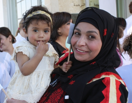 A Palestinian woman and her daughter outside the Caritas Baby Hospital in Bethlehem. On May 13, the pope briefly visited the hospital and blessed several infants. Photo by Laura Sheahen/CRS