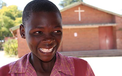 Brenda Ndapasuwa didn't attend school until she was 11. But after just a year and a half of accelerated classwork at Mavambo Learning Center, she entered fifth grade. Photo by Debbie DeVoe/CRS