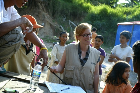 Caritas Austrias' Silvia Holzer stop at the remote village of Kampung Tangah in West Sumatra to distribute much needed aid in the form of hygine kits and tool kits for people who lost thier homes in last weeks devastasting earthquake near Padang City, Indonesia. Photograph by James Alcock/Caritas Internationalis (c) 2009.