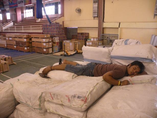 I know how you feel. A Caritas logistician falls asleep during the Sumatra earthquake reponse. Credit: F. Sundoko/Caritas Indonesia