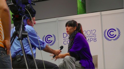 Emilie Johann being interviewed in Doha. Credit: CIDSE