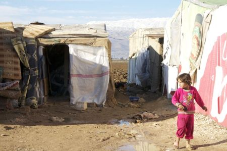 Syrian refugee children face a cold winter in Bekaa Valley. Credit: De Voogd