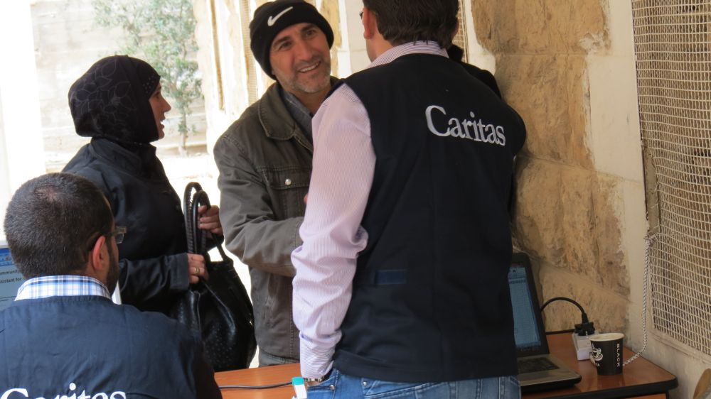 Mohammad Azroun picking up blankets and other aid at a Caritas centre in Madaba.