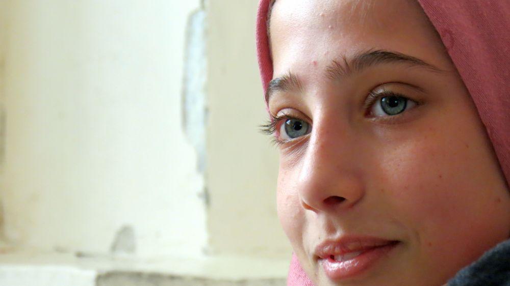 A Syrian refugee at an informal education class run by Caritas Jordan in Zarqa.
