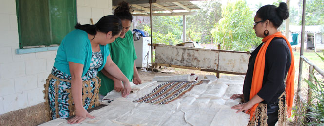 Lisa Vehikite (in green) discusses the Tapa prject with Caritas Tonga staff. Credit: Caritas Aotearoa New Zealand
