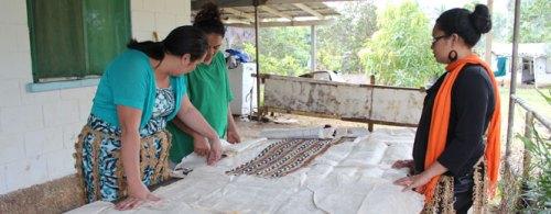 Lisa Vehikite (in green) discusses the Tapa prject with Caritas Tonga staff. Credit: Caritas Aotearoa New Zealand