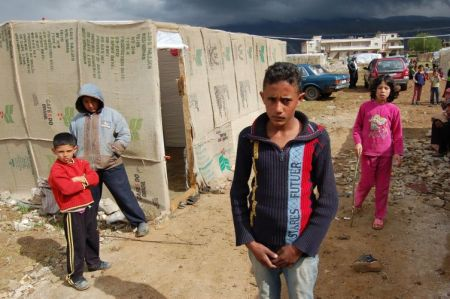 Storm clouds gather over a Syrian refugee camp in Lebanon. Credit:  Andreas Zinggl/Caritas Austria