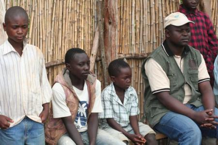 Eight year old Germain Muhindo, third from left, sits with two other ex child soldiers at the Caritas centre. Photo Taylor Toeka