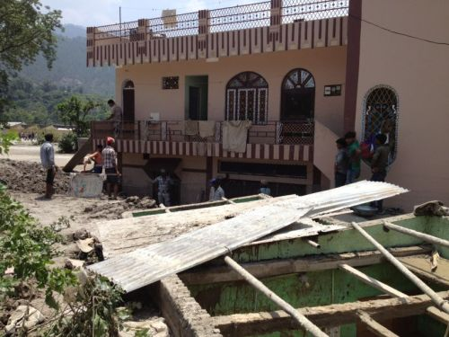 Caritas India is getting volunteers to help local communities clean the mud. Credit Caritas India