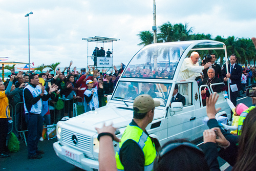 Pope Francis greeting pilgrims along the Copacobana waterfront. Copyright: Caritas Brazil/Nando Zamban