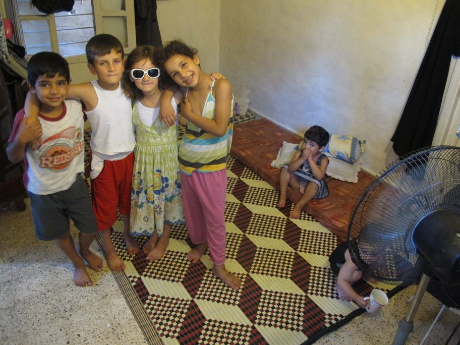 Some of the children who share Amena's appartment. Photo by Nick Harrop/CAFOD