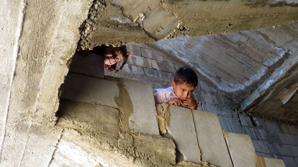Children on the stairwell of the half built apartment block where Hoda lives. Photo by Patrick Nicholson