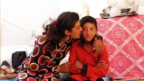 Gharam and Nafeh look after each other after they lost their mother. Photo by Patrick Nicholson/Caritas