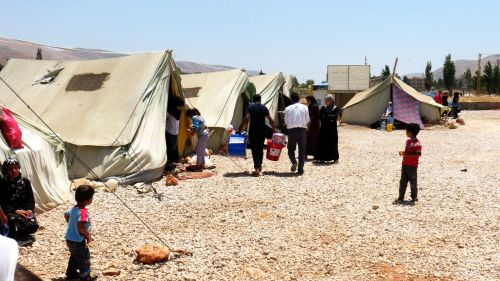 Caritas delivering aid in Bekaa Valley to Syrian refugees. Photo by Patrick Nicholson/Caritas