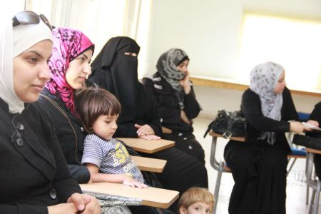 Hanan with her son in the counselling sessions with other  Syrian refuge mothers at the Caritas Centre in Zarqa. Credit: Caritas Jordan