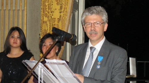 Caritas secretary general Michel Roy with the Order of Merit pinned to his lapel. Credit: Caritas/Michelle Hough
