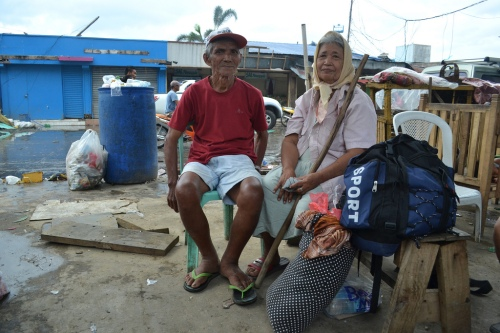 Gerardo Amantillo (74) and Jovita Amantillo (74) from Basey, close to Tacloban on Leyte island. They were swept out of their home by waves and survived by clinging onto the roof of a neighbours house. They are photographed at Ormoc pier, where they were queuing for over 30 hours to get a boat off the island. (Photo: Eoghan Rice - Trócaire / Caritas)