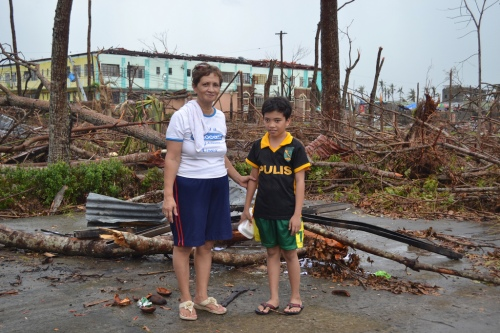 Mulvarosa Pepilla Perote (57) and her grandson Brynzsly (12). They survived the typhoon but Mulvarosa's nephew, his wife, mother-in-law and 9 month old child have not been seen since. They lived close to the sea in an area that was destroyed by waves. (Photo: Eoghan Rice - Trócaire / Caritas)