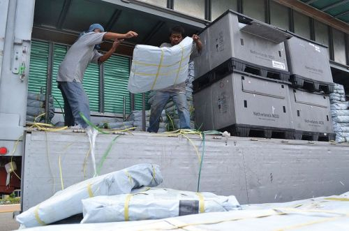 6,500 shelter kits arrive in Cebu port (November 17th) to be shipped to Leyte island, where they will be distributed to people who lost their homes in Typhoon Yolande/Haiyan. This is the first batch of Caritas shelter kits. Over 30,000 more are due to arrive over the coming days. (Photo: Eoghan Rice - Trócaire / Caritas)