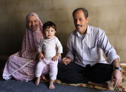 Adnan with wife and granddaughter.  Photo by Val Morgan/Sciaf